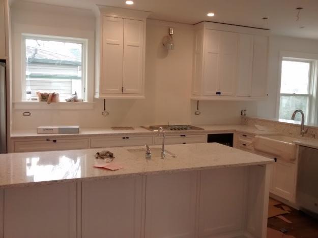 white kitchen cabinets with zodiaq snowdrift countertops