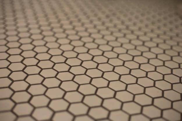 Close-up of hex tile with graphite grout.